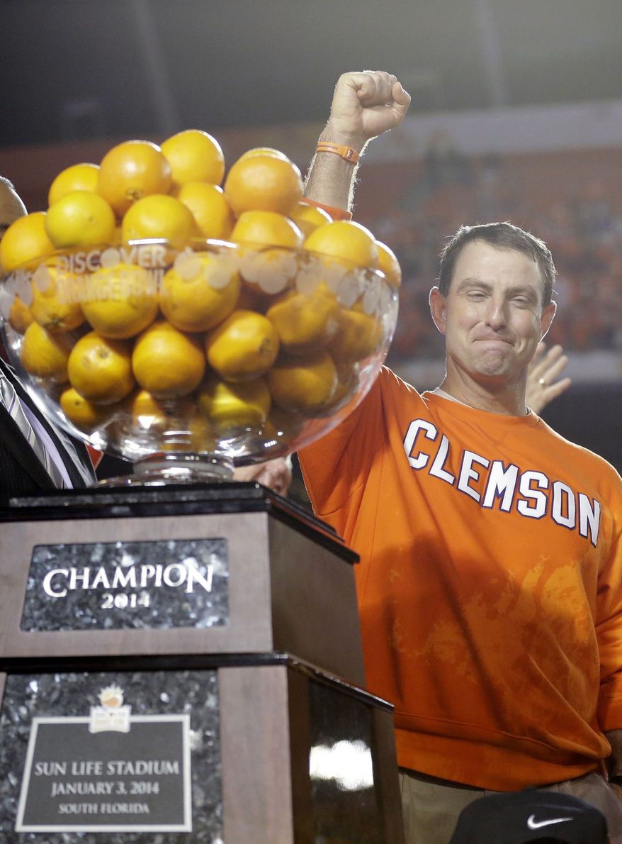 Clemson head coach Dabo Swinney celebrates after Clemson defeated Ohio State 40-3 in the Orange Bowl NCAA college football game, Saturday, Jan. 4, 2014, in Miami Gardens, Fla. (AP Photo/Wilfredo Lee)