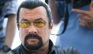 This June 2, 2013, file photo shows actor Steven Seagal looking on as he waits for a news conference of the U.S. congressional delegation to Russia in the U.S. Embassy in Moscow,  Russia. (AP Photo/Alexander Zemlianichenko, File)