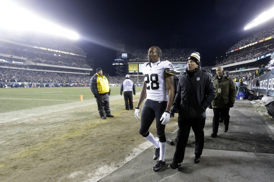 New Orleans Saints' Keenan Lewis walks to the locker room during the second half of an NFL wild-card playoff football game against the Philadelphia Eagles, Saturday, Jan. 4, 2014, in Philadelphia. (AP Photo/Julio Cortez)