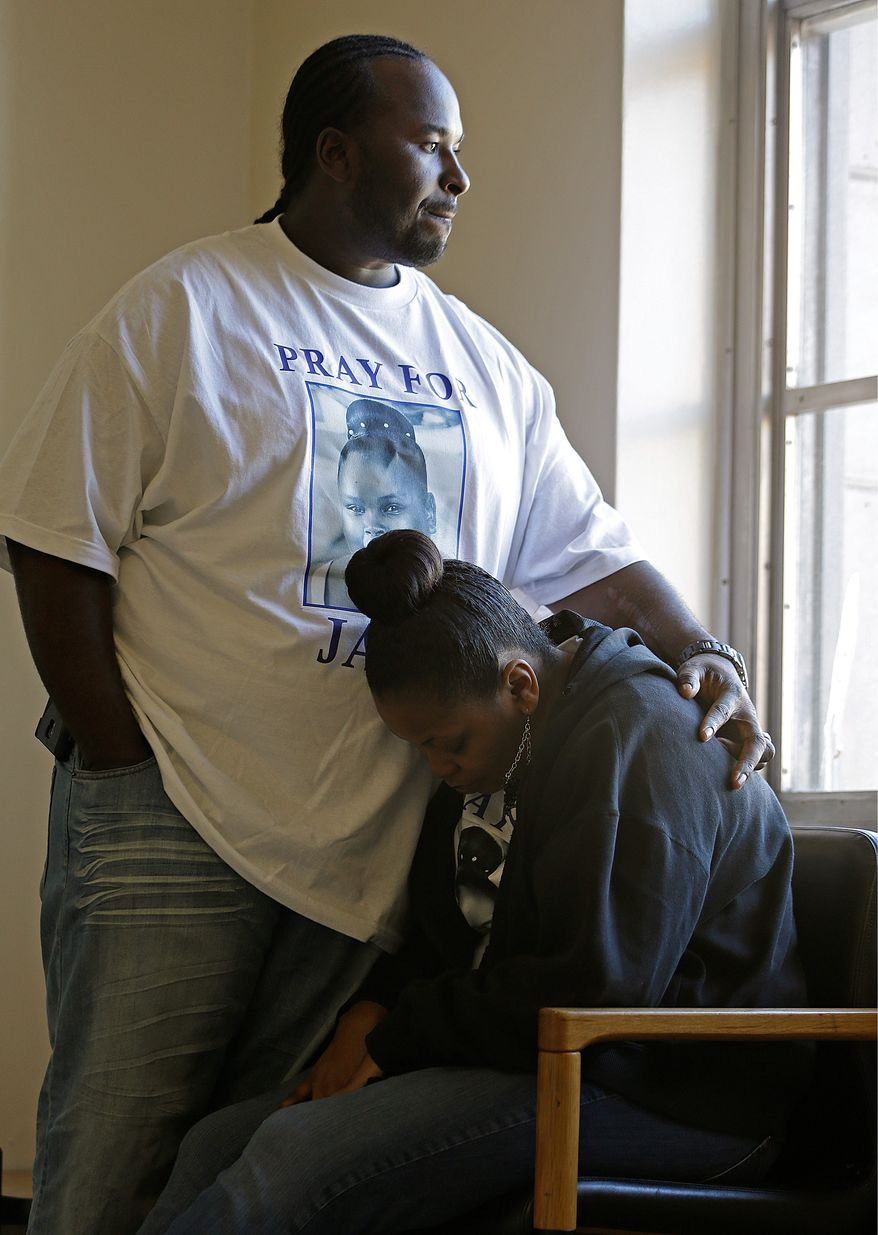Holding on: Martin and Nailah Winkfield are fighting for Mrs. Winkfield's daughter, Jahi McMath, even though doctors have declared her brain dead. (Associated Press)