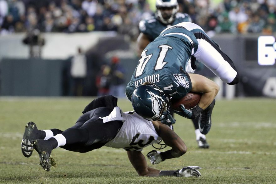 Philadelphia Eagles' Riley Cooper, right, is upended on a hit by New Orleans Saints' Rod Sweeting during the second half of an NFL wild-card playoff football game, Saturday, Jan. 4, 2014, in Philadelphia. (AP Photo/Matt Rourke)