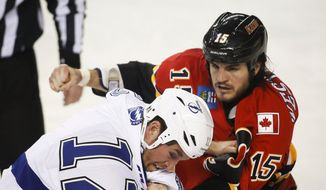 Tampa Bay Lightning's Ryan Malone, left, fights with Calgary Flames' Kevin Westgarth during the first period of an NHL hockey game Friday, Jan. 3, 2014, in Calgary, Alberta. (AP Photo/The Canadian Press, Jeff McIntosh) **FILE**