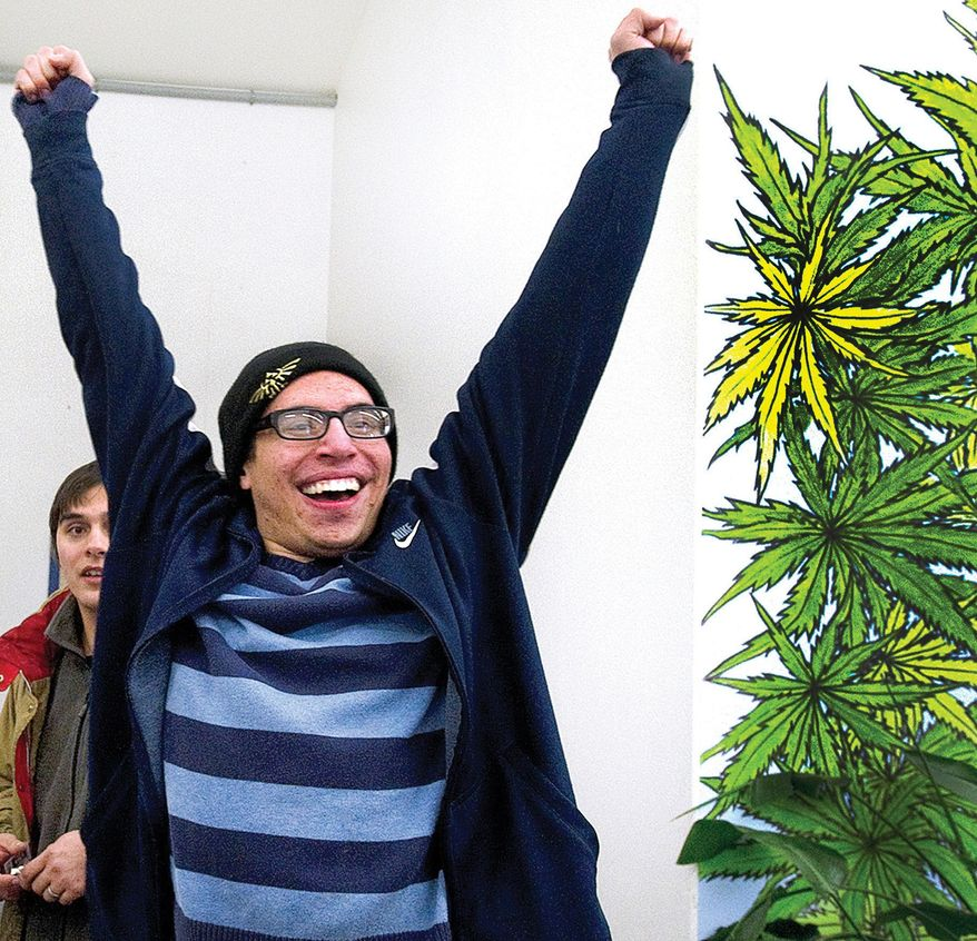 Puebloan Dylan Aragon cheers after being the first resident to purchase recreational marijuana at Marisol Theraputics shortly after 8 a.m. Wendesday, Jan. 1, 2014, in Pueblo West, Colo.  He and friend Caleb Pratt, left, lined up at 2:30 a.m. to be the first to buy pot legally at the store. (AP Photo, Chris McLean/The Pueblo Chieftain)