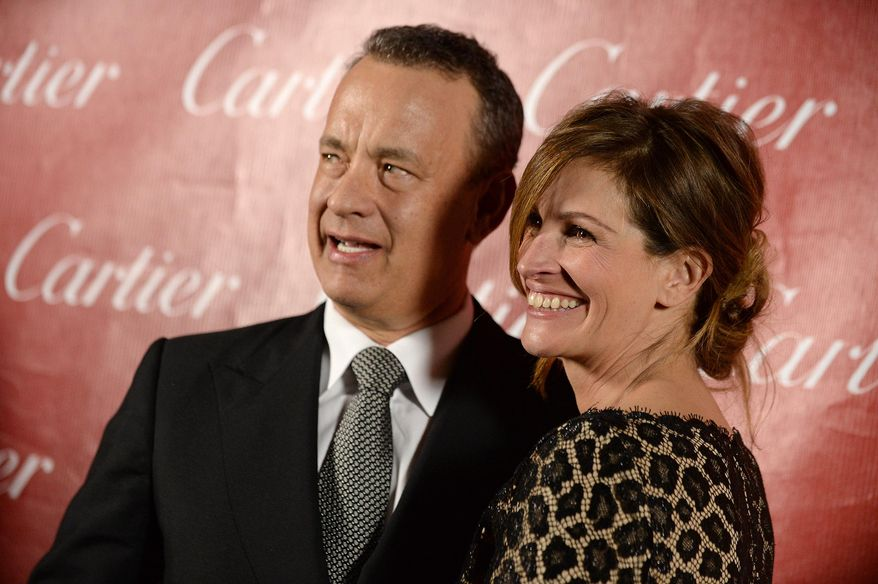 Tom Hanks, left, and Julia Roberts pose backstage at the Palm Springs International Film Festival Awards Gala at the Palm Springs Convention Center on Saturday, Jan. 4, 2014, in Palm Springs, Calif. (Photo by Jordan Strauss/Invision/AP)