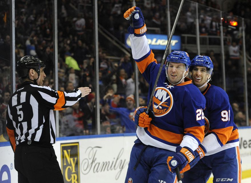 New York Islanders' Thomas Vanek (26) and John Tavares (91) celebrate Vanek's goal against the Chicago Blackhawks in the second period of an NHL hockey game on Thursday, Jan. 2, 2014, in Uniondale, N.Y. (AP Photo/Kathy Kmonicek)