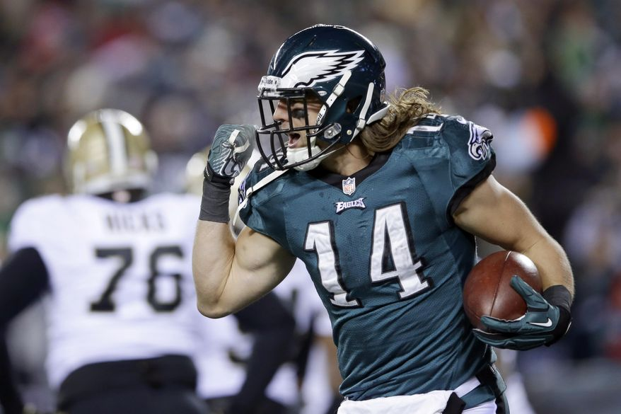 Philadelphia Eagles' Riley Cooper celebrates after scoring a touchdown during the first half of an NFL wild-card playoff football game against the New Orleans Saints, Saturday, Jan. 4, 2014, in Philadelphia. (AP Photo/Michael Perez)