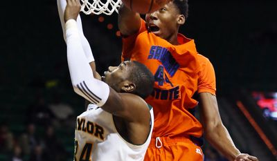 Savannah State forward Jyles Smith (44) blocks the shot of Baylor forward Cory Jefferson, left, during the second half of an NCAA college basketball game, Friday, Jan. 3, 2014, in Waco, Texas. (AP Photo/Waco Tribune Herald, Rod Aydelotte)
