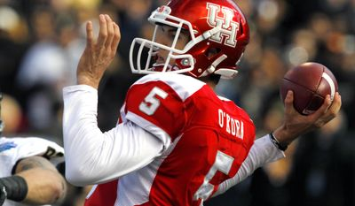 Houston quarterback John O'Korn (5) throws down field during the first half of the BBVA Compass Bowl NCAA college football game against Vanderbilt on Saturday, Jan. 4, 2014, in Birmingham, Ala. (AP Photo/Butch Dill)