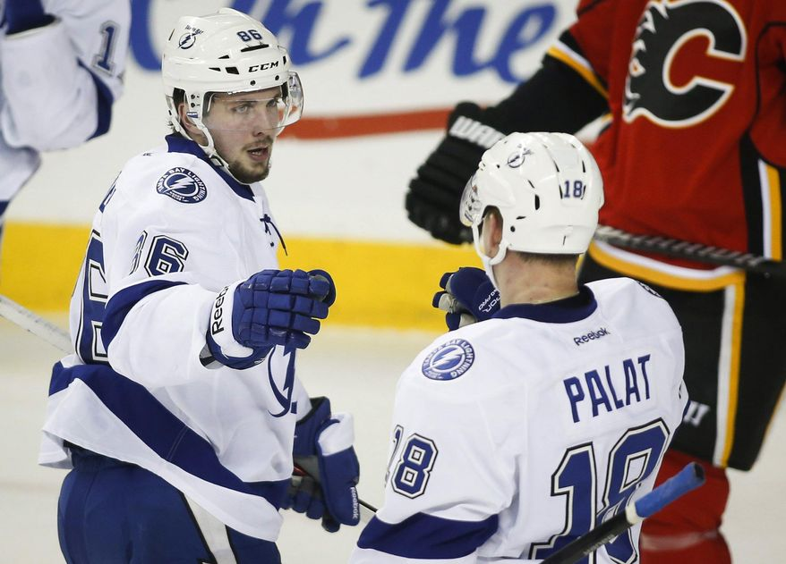 Tampa Bay Lightning's Nikita Kucherov, left, from Russia, celebrates his goal with teammate Ondrej Palat, from the Czech Republic, during the second period of an NHL hockey game against the Calgary Flames, Friday, Jan. 3, 2014, in Calgary, Alberta. (AP Photo/The Canadian Press, Jeff McIntosh)