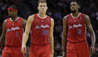 Los Angeles Clippers' Stephen Jackson (1), Blake Griffin (32) and DeAndre Jordan (6) walk on to the court following a timeout against the San Antonio Spurs during the first half on an NBA basketball game, Saturday, Jan. 4, 2014, in San Antonio. (AP Photo/Eric Gay)
