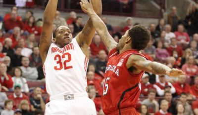 Ohio State's Lenzelle Smith, Jr. (32), puts up a shot against Nebraska's Ray Gallegos (15) during the first half of an NCAA college basketball game Saturday, Jan. 4, 2014, in Columbus, Ohio. (AP Photo/Mike Munden)
