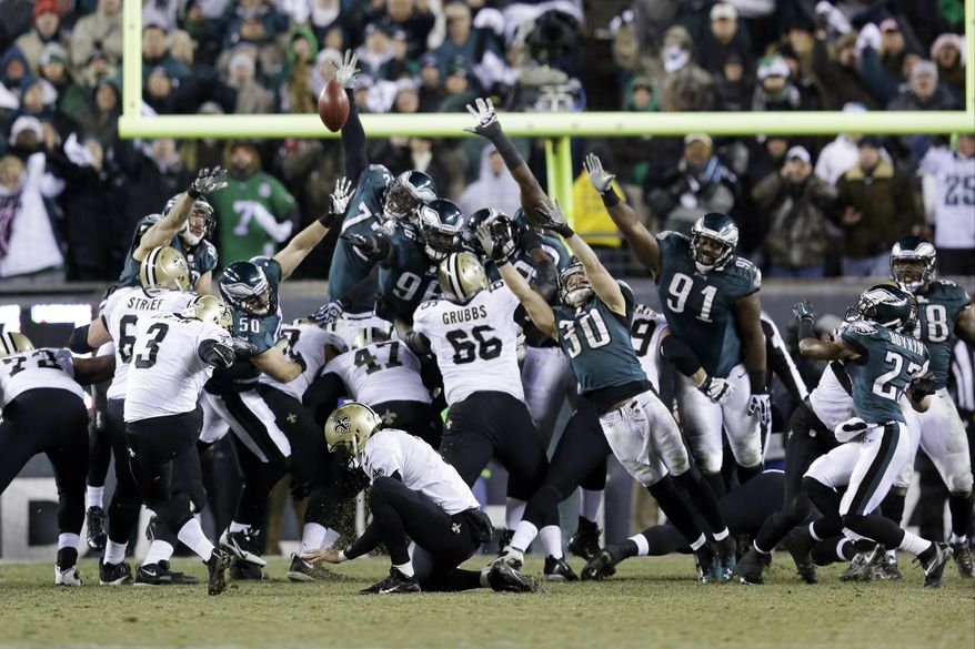 New Orleans Saints' Shayne Graham (3) kicks the game-winning field goal during the second half of an NFL wild-card playoff football game against the Philadelphia Eagles, Saturday, Jan. 4, 2014, in Philadelphia. New Orleans won 26-24. (AP Photo/Julio Cortez)