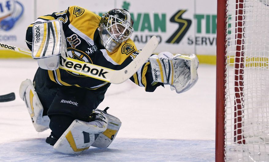 Boston Bruins goalie Niklas Svedberg dives back for a save against the Nashville Predators during the first period of an NHL hockey game, Thursday, Jan. 2, 2014, in Boston. (AP Photo/Charles Krupa)