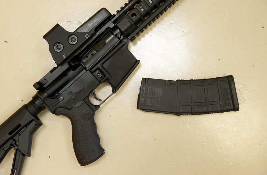 FILE - Gun sales spiked after Sandy Hook and as Congress and a number of states debated whether to impose more restrictions on firearms purchases. Congress stalemated, but some states moved forward.. (AP Photo/Rich Pedroncelli, File)