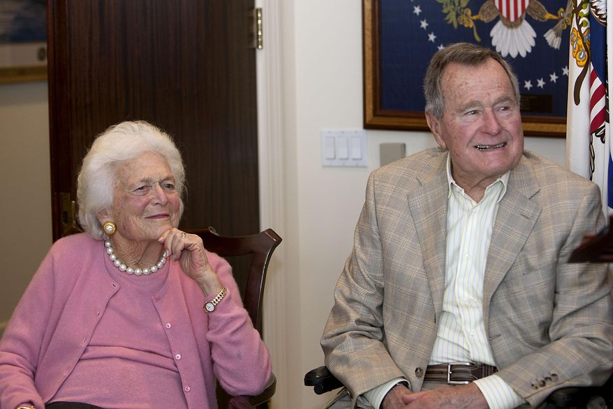 ** FILE ** In this Dec. 23, 2013, photo, former first lady Barbara Bush left, and former President George H. W. Bush look on during a ceremony at his office in Houston. (AP Photo/Houston Chronicle, James Nielsen)