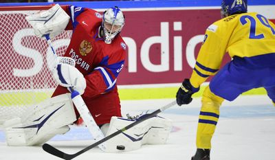 Russia's goalie Andrei Vasilevski makes a save in front of Sweden's Oskar Sundqvist, right, in the World Junior Hockey Championships semifinal between Sweden and Russia at Malmo Arena in Malmo, Sweden on Saturday, Jan. 4, 2014. (AP Photo/TT News Agency, Ludvig Thunman) SWEDEN OUT