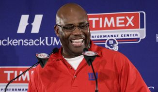 New York Giants defensive coordinator Perry Fewell talks to the media during NFL football practice, Thursday, Jan. 12, 2012, in East Rutherford, N.J. The Giants travel to Green Bay, Wis., to play the Green Bay Packers in an NFC divisional playoffs game on Jan. 15. (AP Photo/Julio Cortez)