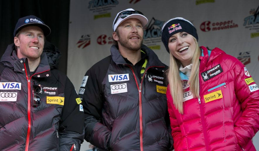 ** FILE ** Ted Ligety, left, Bode Miller, Lindsey Vonn stand together at a U.S. Ski Team event at Copper Mountain, Colo., on Friday, Nov. 8, 2013. (AP Photo/Nathan Bilow)