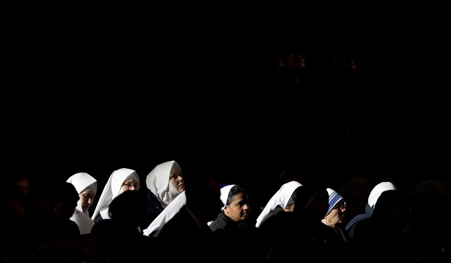 Nuns attend a mass celebrated by Pope Francis in St. Peter's Basilica, at the Vatican, to mark Epiphany, Monday, Jan. 6, 2014. The Epiphany day, is a joyous day for Catholics in which they recall the journey of the Three Kings, or Magi, to pay homage to Baby Jesus. (AP Photo/Andrew Medichini)