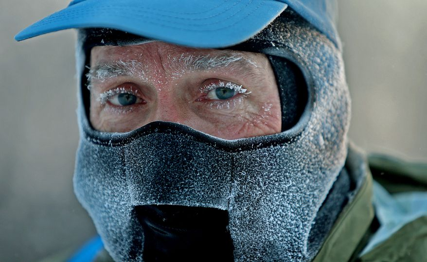 "** FILE ** John Brower snow in his eye lashes after running to work in the frigid -20 weather Monday, Jan. 6, 2014, in Minneapolis. A whirlpool of frigid, dense air known as a ""polar vortex"" descended Monday into much of the U.S. (AP Photo/The Star Tribune,  Elizabeth Flores)"