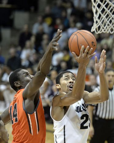 Colorado's Spencer Dinwiddie drives to the basket past Oregon State's Eric Moreland during an NCAA college basketball game Thursday, Jan. 2, 2014, in Boulder, Colo. (AP Photo/Daily Camera, Jeremy Papasso) NO SALES