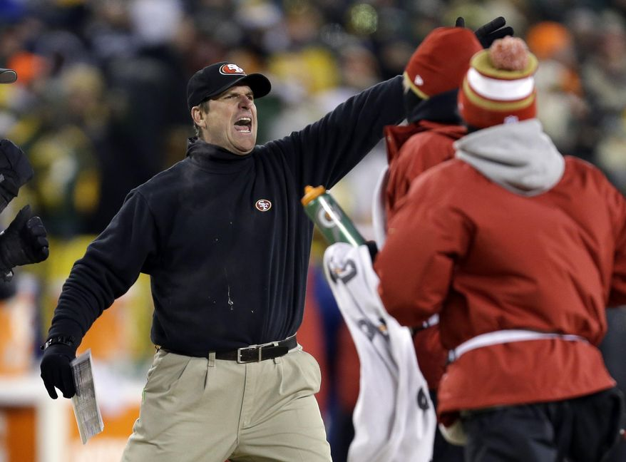 San Francisco 49ers head coach Jim Harbaugh directs his team during the first half of an NFL wild-card playoff football game against the Green Bay Packers, Sunday, Jan. 5, 2014, in Green Bay, Wis. (AP Photo/Mike Roemer)