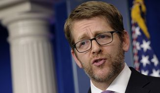 White House press secretary Jay Carney speaks during the daily briefing at the White House in Washington, Monday, Jan. 6, 2014. With Congress back, the Senate is expected to work on a three-month extension of benefits for the long-term unemployed.  (AP Photo/Susan Walsh)