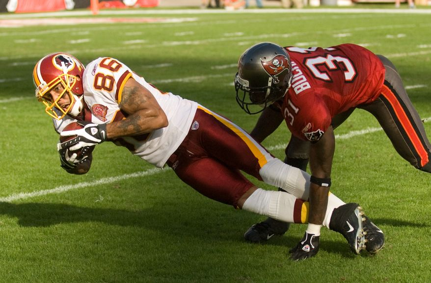 **FILE** Reche Caldwell (86) of the Washington Redskins is taken down by Phillip Buchanon (31) of the Tampa Bay Buccaneers for a gain of 10 yards in the fourth quarter at Raymond James Stadium in Tampa, Fl. Sunday, November 25, 2007. (Michael Connor / Washington Times)