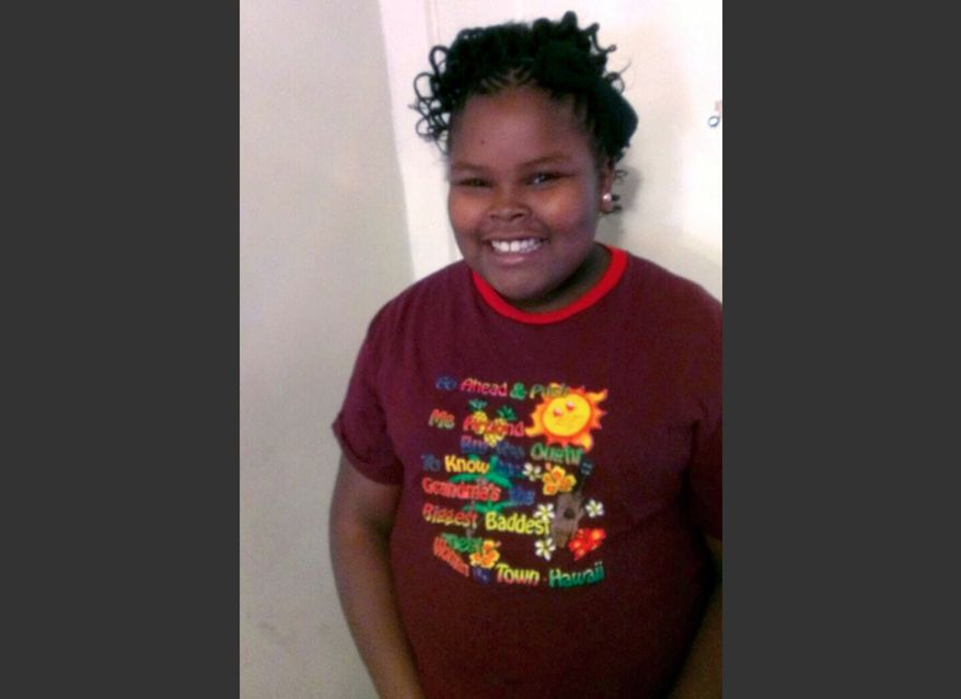 File - This undated file photo provided by the McMath family and Omari Sealey shows Jahi McMath. The family attorney of the California girl declared brain dead after a tonsillectomy says she has been taken out of Children's Hospital of Oakland. Christopher Dolan tells The Associated Press that McMath left the hospital in a private ambulance shortly before 8 p.m. Sunday Jan. 5, 2014. (AP Photo/Courtesy of McMath Family and Omari Sealey, File)