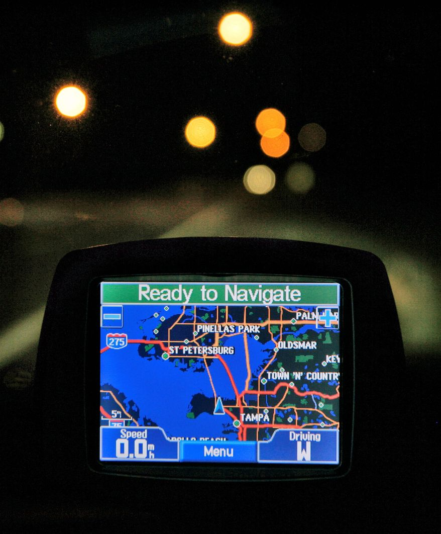 "A Garmin GPS unit is shown inside a vehicle in Tampa, Fla. ""Currently, no comprehensive federal privacy law governs the collection, use, and sale of personal information by private-sector companies,"" a Government Accountability Office report stated. (Associated Press)"