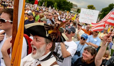 "**FILE** William Temple (left), dressed in a tri-corner hat, cheers for speakers during ""Audit the IRS,"" a tea party rally against the Internal Revenue Service on the West Lawn of the U.S. Capitol in Washington on June 19, 2013. (Andrew Harnik/The Washington Times)"