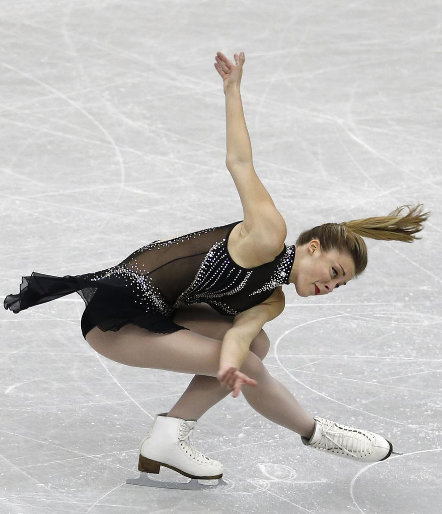FILE - In this Dec. 5, 2013, file phot, Ashley Wagner, of the United States, performs during the ladies' short program at Grand Prix Final figure skating competition at Marine Messe Fukuoka in Fukuoka, western Japan. Wagner is, by far, the best American bet for an individual medal in Sochi. By finishing fifth at the worlds last year and Gracie Gold getting sixth, they secured the maximum three spots for the Olympics. (AP Photo/Shizuo Kambayashi, File)