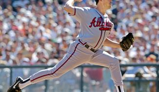 Atlanta Braves starting pitcher Greg Maddux delivers a pitch in the first inning against the San Francisco Giants during Game 3 of the National League Division Series in San Francisco, Saturday, Oct. 5, 2002.  (AP Photo/Julie Jacobson)