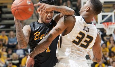 Long Beach State's Tyler Lamb, left, loses the ball as he collides with Missouri's Earnest Ross, right, during the second half of an NCAA college basketball game Saturday, Jan. 4, 2014, in Columbia, Mo.  Missouri won 69-59. (AP Photo/L.G. Patterson)