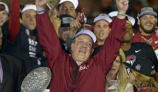 Florida State head coach Jimbo Fisher reacts with The Coaches' Trophy after the NCAA BCS National Championship college football game against Auburn Monday, Jan. 6, 2014, in Pasadena, Calif. Florida State won 34-31 (AP Photo/Mark J. Terrill)
