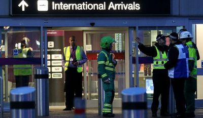 Emergency services attend the scene following the discovery of a suspicious package, at Edinburgh Airport after the airport was evacuated in Edinburgh, Scotland, Tuesday Jan. 7, 2014. Explosive disposal experts are at the scene. Several outbound flights have been canceled, while inbound flights have been diverted to Glasgow Airport, about 50 miles (80 kilometers) away. (AP Photo/Andrew Milligan, PA)