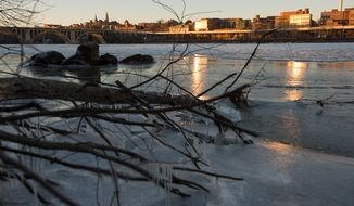Ice drifts down the Potomac River past Georgetown seen from Roosevelt Island as the region dips into single digit temperatures, Washington, D.C., Tuesday, January 7, 2014. (Andrew Harnik/The Washington Times)