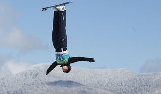 FILE - In this Jan. 20, 2011, file photo, Ashley Caldwell, of the United States, practices for the women's aerials at the World Cup freestyle skiing event in Lake Placid, N.Y. The budding U.S. aerials star considers herself a grizzled veteran after tearing the ACLs in both of her knees in a span of 363 days between 2011-12, though the injuries have done little to deter her from keeping her sights set on Sochi.  (AP Photo/Mike Groll, File)