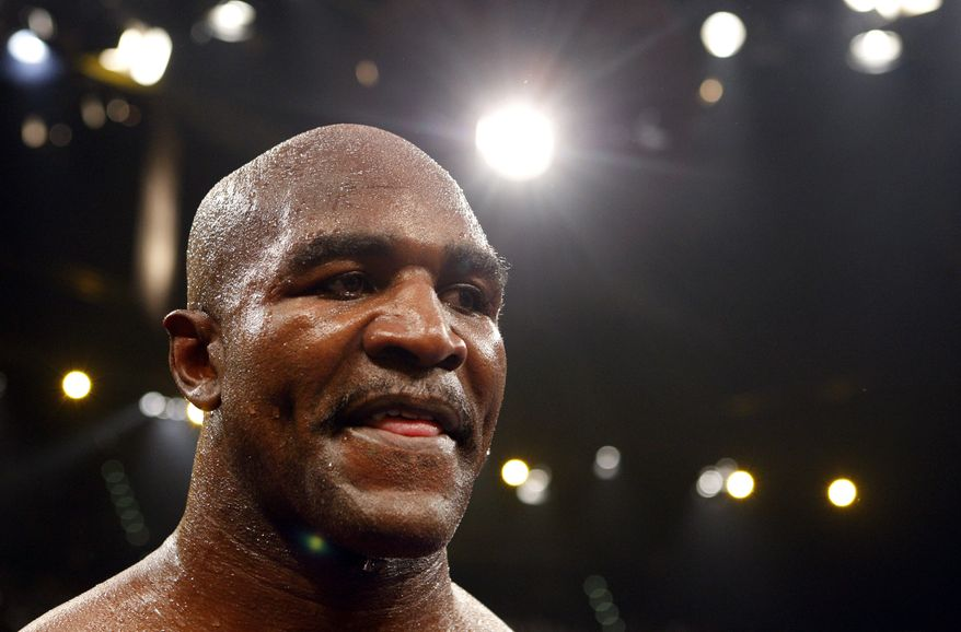 "FILE - In  this Dec. 20, 2008, file photo, boxer Evander Holyfield, from United States, reacts after losing against Nikolai Valuev, of Russia, in a WBA heavyweight title fight at the Hallenstadion, in Zurich, Switzerland. The former world heavyweight champion has been reprimanded by the bosses of a British reality TV show for saying being gay ""ain't normal."" The 50-year-old American made the comments during a conversation with a fellow contestant on Celebrity Big Brother in an episode that was aired Sunday, Jan. 5, 2014, in Britain. (AP Photo/Matthias Schrader, File)"