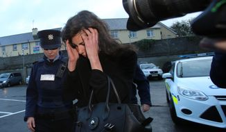 Jenny Lauren, centre, Niece of fashion designer Ralph Lauren, arrives at  Killaloe District Court, in Killaloe, Ireland, Tuesday, Jan. 7, 2014. The niece of fashion designer Ralph Lauren has appeared in an Irish court on charges of being drunk and disorderly on a New York-bound plane. Jewelry designer Jenny Lauren was arrested after a Delta flight from Barcelona made an unscheduled stop at Shannon Airport on Monday.  (AP Photo/PA, Niall Carson) UNITED KINGDOM OUT NO SALES NO ARCHIVE