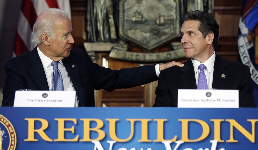 Vice President Joe Biden, left, talks to New York Gov. Andrew Cuomo during a discussion on the state's rebuilding efforts following Superstorm Sandy, Tuesday, Jan. 7, 2014, in the Red Room at the Capitol  in Albany, N.Y. The state has received federal disaster funds for relief and rebuilding, with an estimated $5.1 billion in the current fiscal year's budget. (AP Photo/Mike Groll)