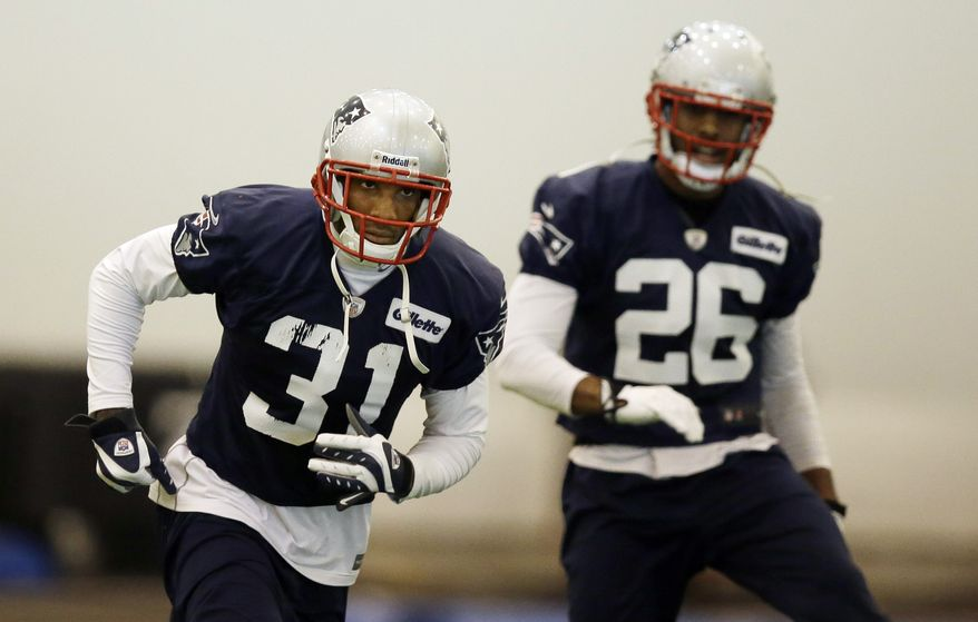 New England Patriots cornerback Aqib Talib (31) and defensive back Logan Ryan (26) run during a stretching session before NFL football practice at the team's facility in Foxborough, Mass., Tuesday, Jan. 7, 2014. The Patriots are scheduled to host the Indianapolis Colts in an NFL football divisional playoff game on Saturday, Jan. 11. (AP Photo/Stephan Savoia)