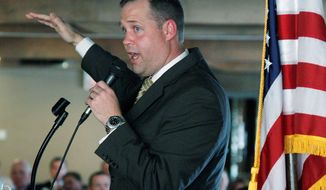 ** FILE ** In this Wednesday, Nov. 7, 2012, file photo, Oklahoma Congressman-elect Jim Bridenstine, R-Oklahoma, gestures as he speaks in Tulsa, Okla. While Oklahoma's four House and Senate veterans, who have a combined 60 years of legislative experience, typically follow their leaders, two freshmen House members, Bridenstine and Markwayne Mullin, have emerged as a new breed. (AP Photo/Sue Ogrocki, File)
