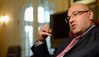 Speaking out: Lukman Faily, Iraqi ambassador to the United States, says the Obama administration is not as engaged in his country's future as was the Bush administration, but adds that sectarian divisions are not about to erupt into civil war. (Andrew Harnik/The Washington Times)