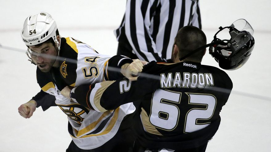 Boston Bruins defenseman Adam McQuaid, left, and Anaheim Ducks' Patrick Maroon brawl during the second period of an NHL hockey game in Anaheim, Calif., Tuesday, Jan. 7, 2014. (AP Photo/Chris Carlson)