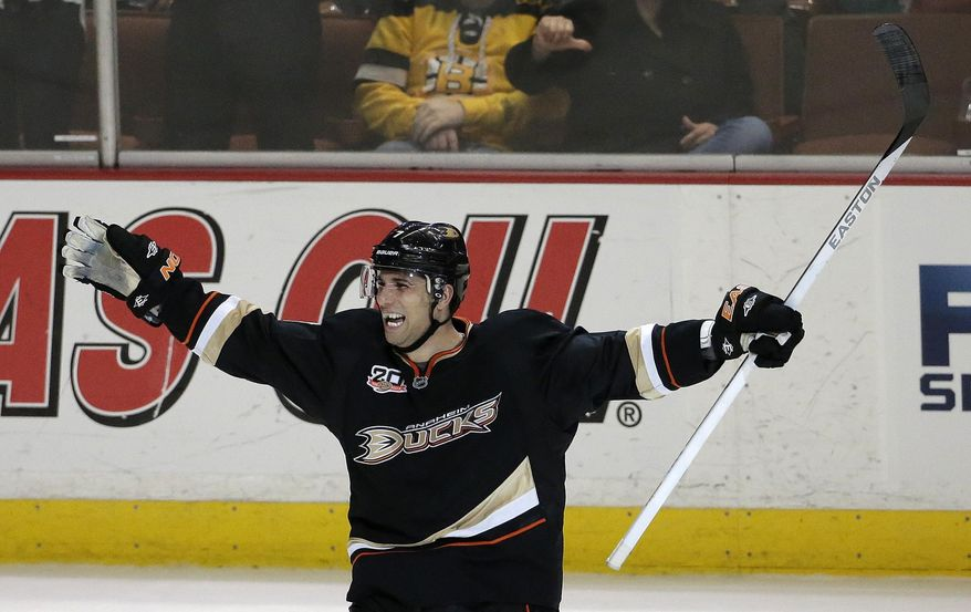 Anaheim Ducks center Andrew Cogliano celebrates his goal during the second period of an NHL hockey game against the Boston Bruins in Anaheim, Calif., Tuesday, Jan. 7, 2014. (AP Photo/Chris Carlson)