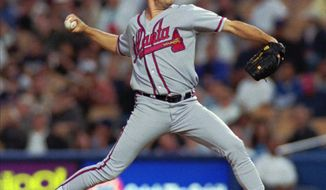 Atlanta Braves pitcher Greg Maddux throws in the second inning against the Los Angeles Dodgers on Wednesday, May 3, 2000, in Los Angeles. Maddux was handed his first defeat of the year as the Dodgers won 6-4. This was Maddux's first loss against the Dodgers since 1993. (AP Photo/John Hayes)