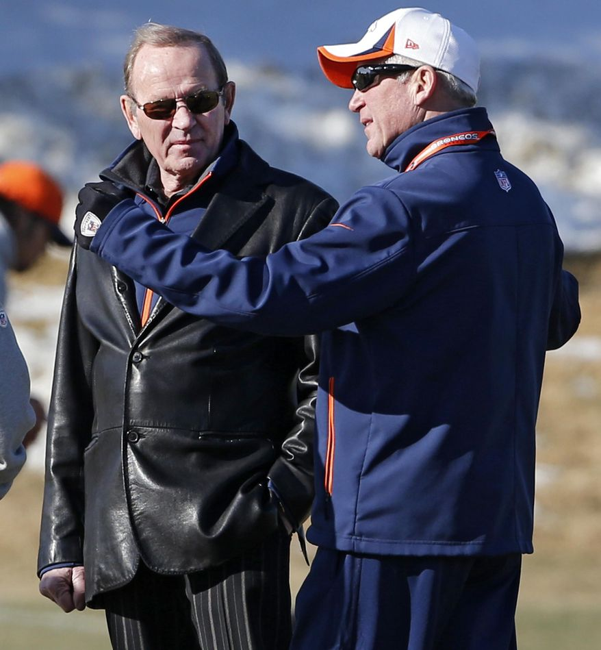 Denver Broncos coach John Fox, right, talks to owner Pat Bowlen during practice for the football team's NFL playoff game against the San Diego Chargers at the Broncos training facility in Englewood, Colo., on Wednesday, Jan. 8, 2014. AP Photo/Ed Andrieski)