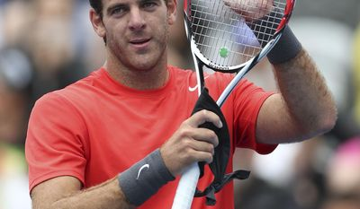 Juan Martin del Potro of Argentina holds his racquet up and claps after winning his match against Nicolas Mahut of France during the Sydney International Tennis Tournament in Sydney, Australia, Wednesday, Jan. 8, 2014. (AP Photo/Rob Griffith)