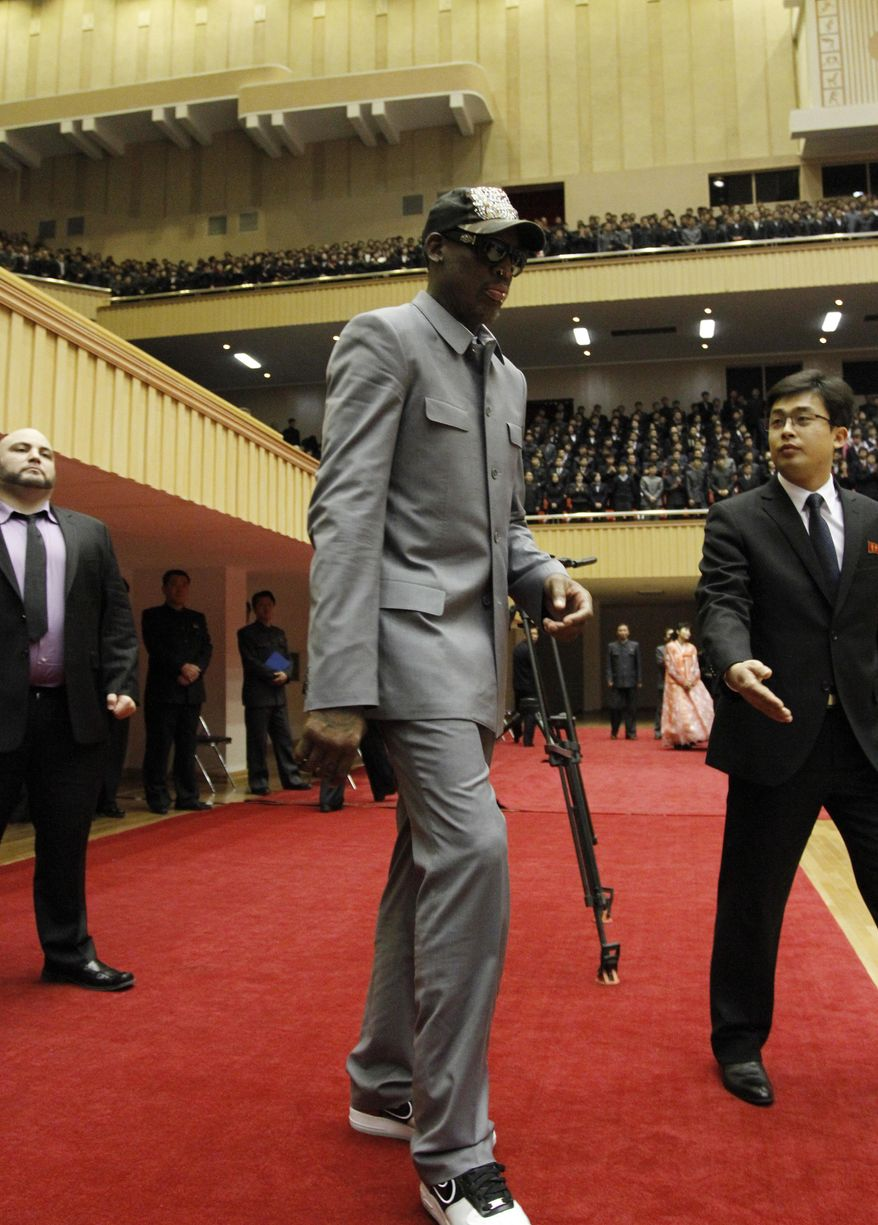 Dennis Rodman walks along the court at an exhibition basketball game between U.S. and North Korean players at an indoor stadium in Pyongyang, North Korea on Wednesday, Jan. 8, 2014. (AP Photo/Kim Kwang Hyon)
